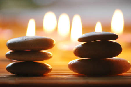 Stacked pebbles and scented candles in the dark Stock Photo - 779172