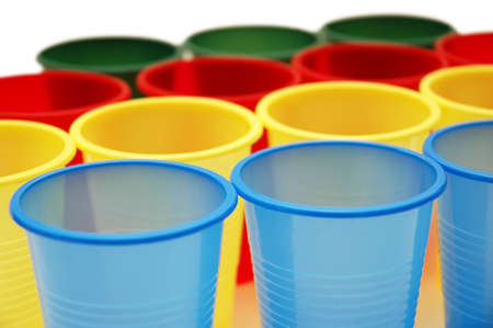 Plastic cups of various colours isolated on white photo
