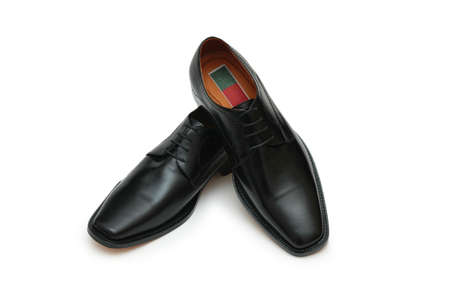 Male black shoes isolated on the white photo