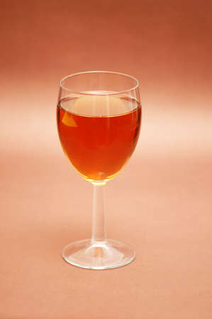 Glass of liqueur over the biege background Stock Photo - 803500