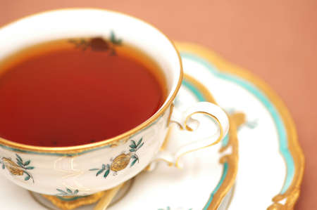 biege: Cup  of black tea on biege background