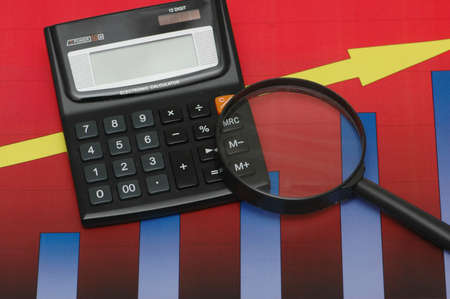 Business results under  scrutiny - calculator and charts photo