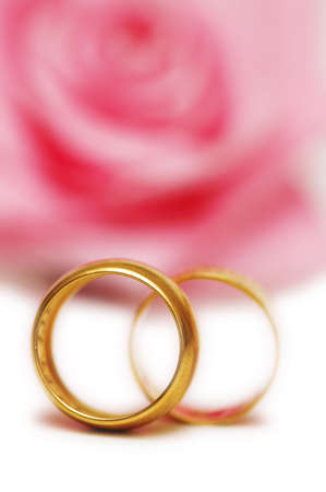 Two  wedding rings and pink rose at the background Stock Photo - 803535