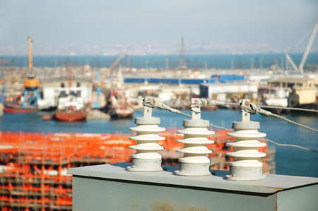 Electricity board and  sea port at the background photo