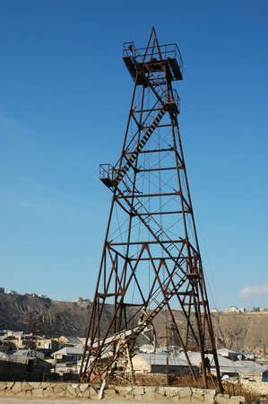 Old oil derrick  during bright summer day Stock Photo