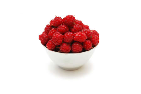 Bowl full of  raspberries isolated on white Stock Photo - 836797