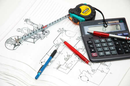 Design drawings,  calculator, pens and measuring tape Stock Photo