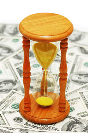 Time is money with dollar notes and  hourglass