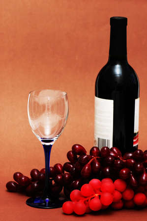 Wine glass, grapes and bottle on  biege background Stock Photo - 861287