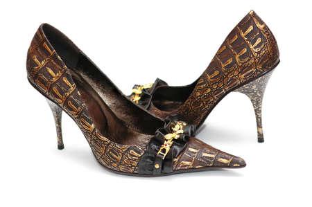 Pair of shiny female shoes isolated on white photo