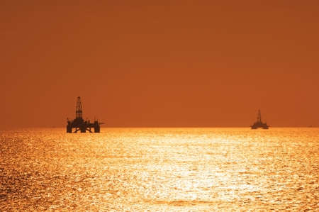 Two offshore oil rigs during sunset  in Caspian sea Stock Photo - 888749