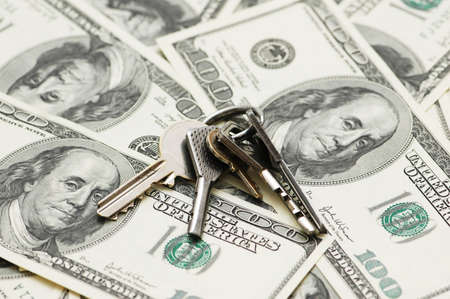 House keys over the hundred dollar bank  notes photo