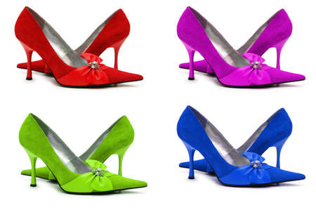 Woman shoes of four different colors  isolated on white photo