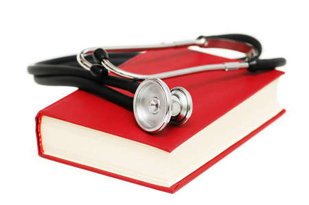 Stethoscope on the red book isolated on white Stock Photo - 927386