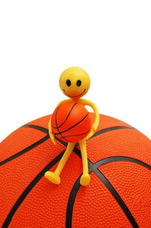 tabassum: Smilie sitting on basketball  isolated on white Stock Photo