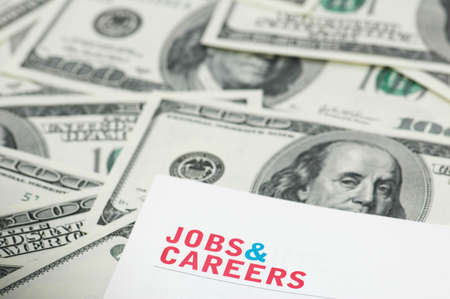 Employment concept  - Job and careers words over dollars photo