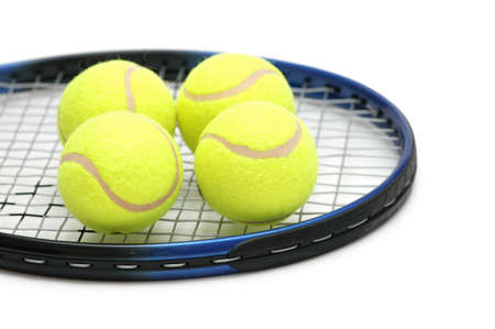 raquet: Tennis balls on the  racket - isolated on white Stock Photo