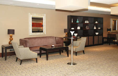 Lobby of the hotel with  sofas and shelves photo