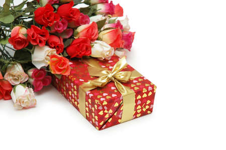 Roses and gift box  isolated on white photo
