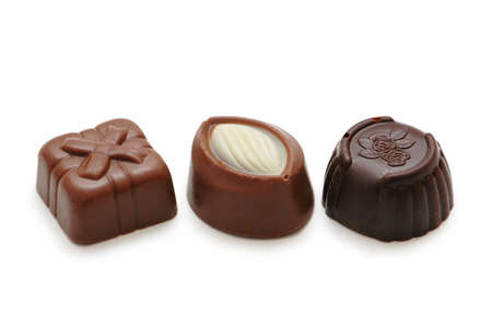 goodie: Three chocolates isolated on  the white background