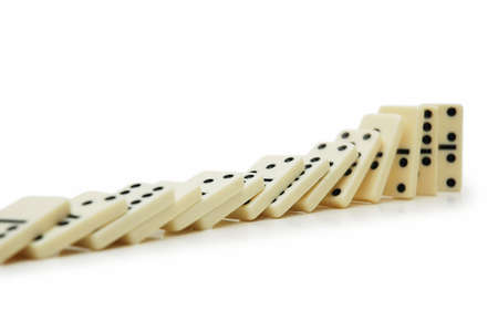 cause and effect: Domino effect - dominos isolated on the white Stock Photo