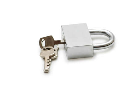 Silver padlock and keys  isolated on the white photo