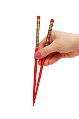 Hand holding chopsticks isolated on the white Stock Photo - 1065231