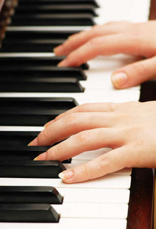 Two hands playing music on the  piano Stock Photo - 1065238