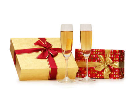 Giftboxes and champagne isolated on the  white photo