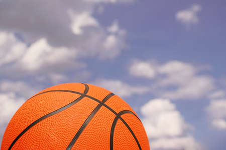 Orange basketball against the  cloudy sky Stock Photo - 1117953
