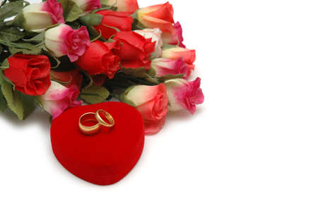 Flowers, heart-shaped box and wedding rings isolated on white Stock Photo - 1215602
