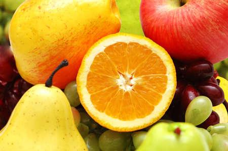 half cut: Half cut orange and other colourful fruits