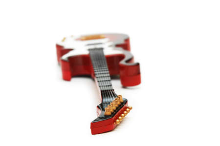 rosewood: Rock guitar with shallow DOF isolated on white