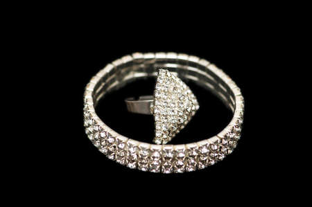 Bracelet and ring isolated on the white photo