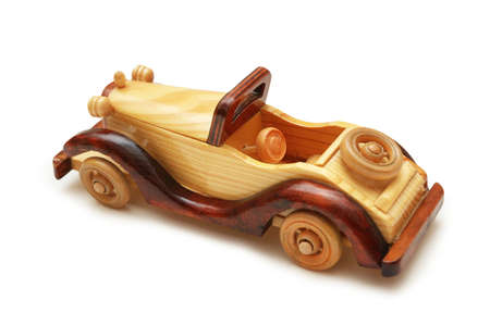 Wooden retro car isolated on the white photo