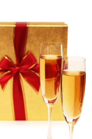 Giftbox and champagne isolated on the white photo