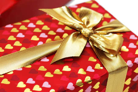 Close up of gift box with golden  ribbon photo