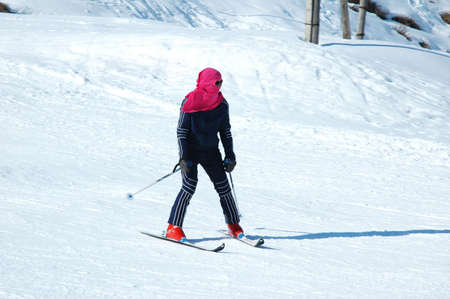 Skier on the snowy slope in winter photo
