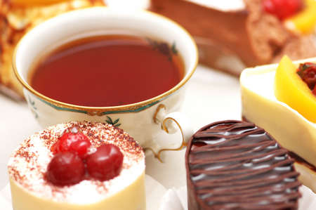 Sweet cake with berries and a cup of tea photo