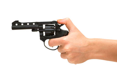 finger on trigger: Hand holding revolver isolated on the white  Stock Photo