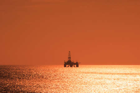 roughneck: Offshore oil rig during sunset  in Caspian sea Stock Photo