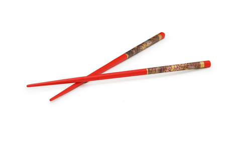 Red chopsticks isolated on the white background Stock Photo - 1888082