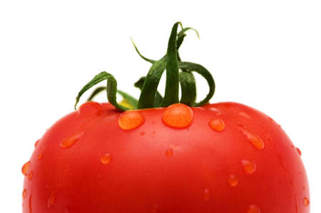 Tomato with water droplets isolated on white photo