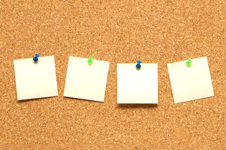 Yellow post it notes on the corkboard Stock Photo - 2138302