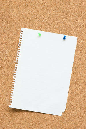 Blank page attached to corkboard with two pins photo