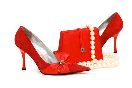 Red shoes, purse and pearl necklace isolated photo