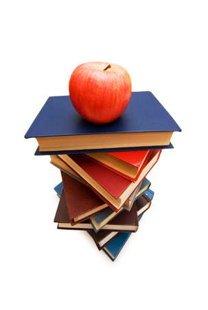 Red apple on top of the book stack