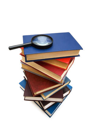 Magnifying glass over the stack of books Stock Photo - 2221687