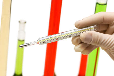 weather gauge: Hand holding thermometer and tubes at the background Stock Photo