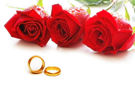 wedding rings: Three roses and rings isolated on the white